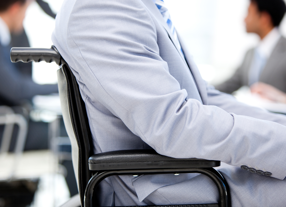 Close-up of a businessman sitting on a wheelchair in a meeting
