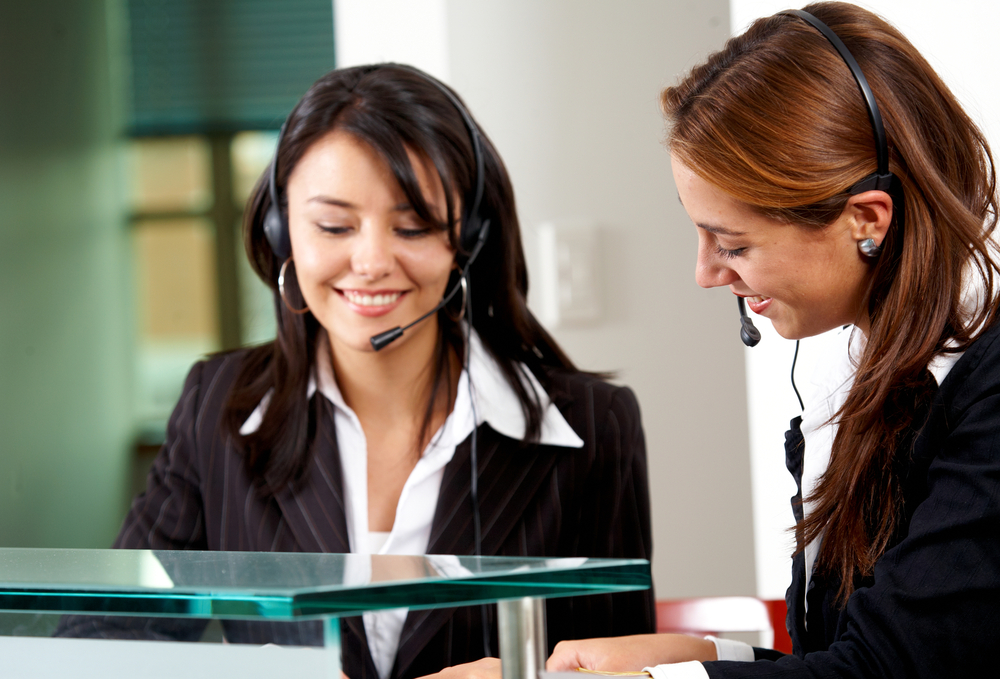 beautiful business customer service women - smiling in an office